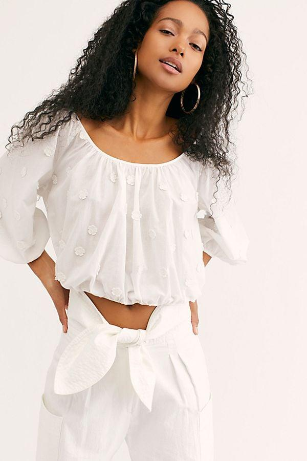 """<p>This pretty cropped <a href=""""https://www.popsugar.com/buy/Levi%27s%20Kaia%20Top-473860?p_name=Levi%27s%20Kaia%20Top&retailer=freepeople.com&pid=473860&price=70&evar1=fab%3Aus&evar9=46438356&evar98=https%3A%2F%2Fwww.popsugar.com%2Ffashion%2Fphoto-gallery%2F46438356%2Fimage%2F46438395%2FLevi-Kaia-Top&list1=shopping%2Cwhite%2Ctops%2Csummer%2Cblouses%2Csummer%20fashion&prop13=mobile&pdata=1"""" rel=""""nofollow"""" data-shoppable-link=""""1"""" target=""""_blank"""" class=""""ga-track"""" data-ga-category=""""Related"""" data-ga-label=""""https://www.freepeople.com/shop/kaia-top/?category=SEARCHRESULTS&amp;color=010"""" data-ga-action=""""In-Line Links"""">Levi's Kaia Top</a> ($70) is so easy to style.</p>"""