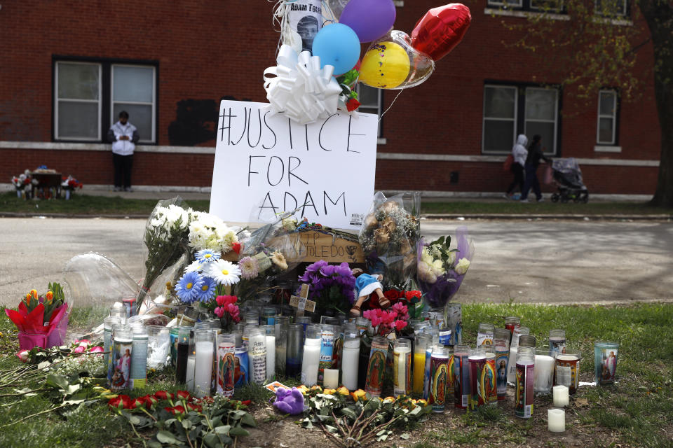 A memorial near the spot where 13-year-old Adam Toledo was shot by a police officer in Chicago's Little Village neighborhood, Friday, April 16, 2021, a day after the body camera video was release of the fatal shooting. (AP Photo/Shafkat Anowar)