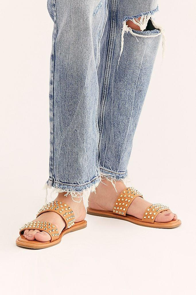 """<h2>Free People</h2><br><strong>Deal: Up To 60% Off</strong><br>Pop by the ethereal fashion retailer's sale section for a dose of equally whimsical shoes (at a fraction of their former price points) — there's everything from square-toed strappy styles to <a href=""""https://www.freepeople.com/shop/penelope-flatform-sandals/"""" rel=""""nofollow noopener"""" target=""""_blank"""" data-ylk=""""slk:platform slides"""" class=""""link rapid-noclick-resp"""">platform slides</a>, <a href=""""https://www.freepeople.com/shop/charlie-v-heels/"""" rel=""""nofollow noopener"""" target=""""_blank"""" data-ylk=""""slk:hot-pink mule-style sandals"""" class=""""link rapid-noclick-resp"""">hot-pink mule-style sandals</a>, and more.<br><br><em>Shop <strong><a href=""""https://www.freepeople.com/sale-shoes/"""" rel=""""nofollow noopener"""" target=""""_blank"""" data-ylk=""""slk:Free People"""" class=""""link rapid-noclick-resp"""">Free People</a></strong></em><br><br><strong>Inuovo</strong> Parker Studded Slide Sandals, $, available at <a href=""""https://go.skimresources.com/?id=30283X879131&url=https%3A%2F%2Fwww.freepeople.com%2Fshop%2Fparker-studded-slide-sandals%2F"""" rel=""""nofollow noopener"""" target=""""_blank"""" data-ylk=""""slk:Free People"""" class=""""link rapid-noclick-resp"""">Free People</a>"""