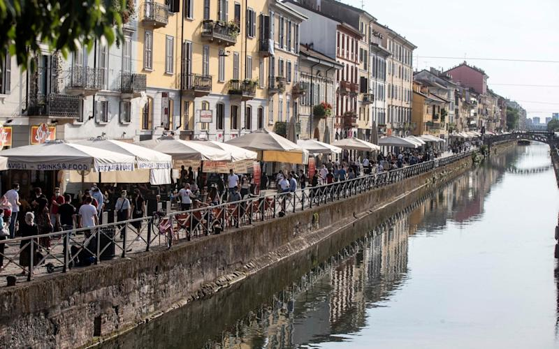 Bars and restaurants along the Naviglio Grande canal in Milan - AP