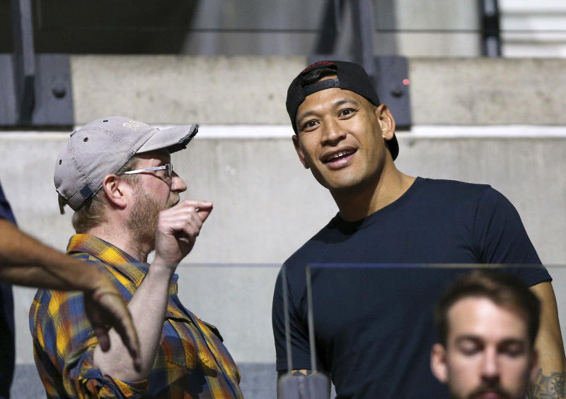 Israel Folau, right, in the stands during the Netball World Cup match between Australia and New Zealand in Liverpool, England, Thursday July 18, 2019. (Nigel French/PA via AP)