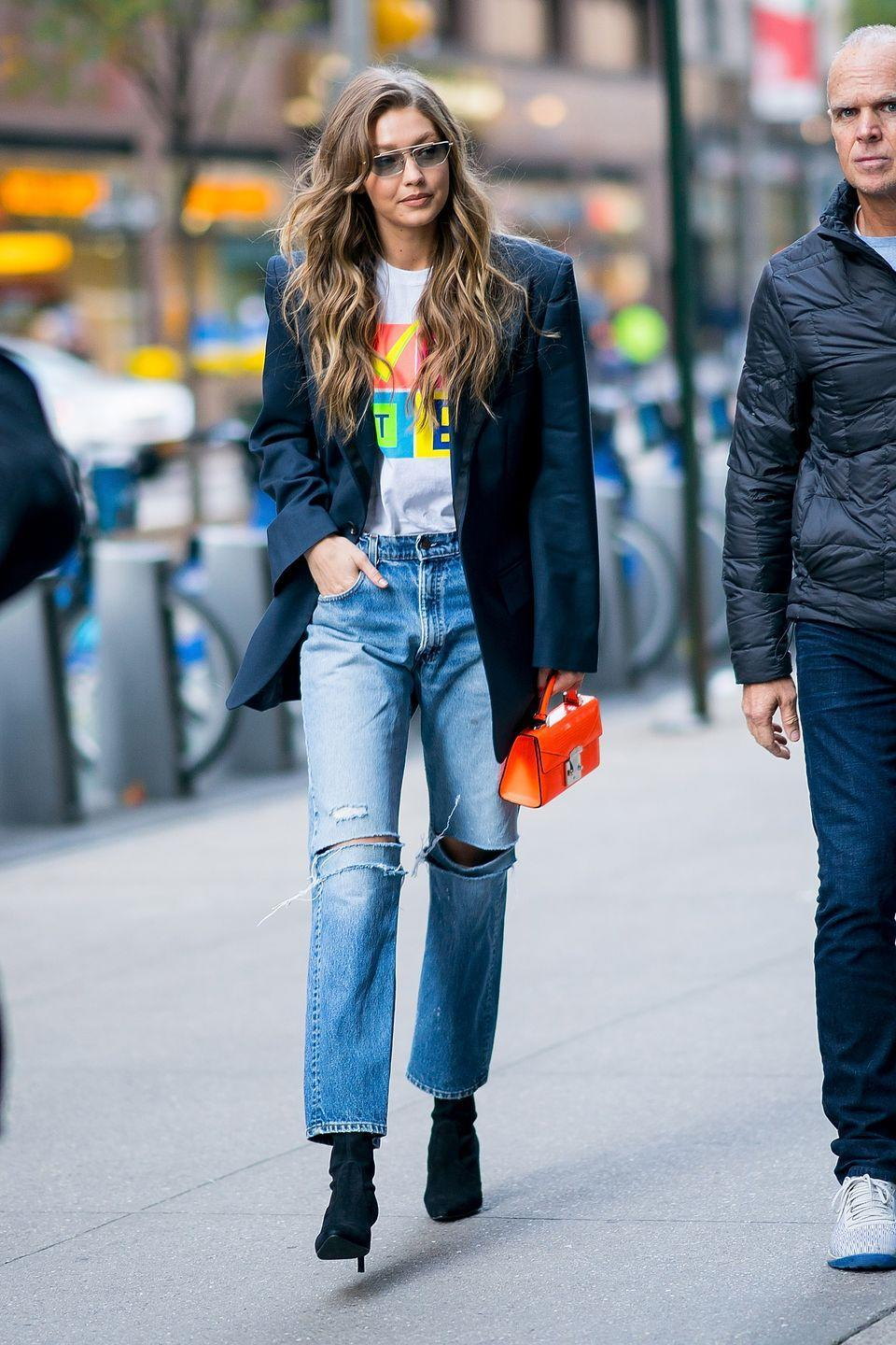 """<p>Gigi pulls together graphic tee and jeans with a structured blazer and a bright mini bag. This is an outfit built for dinner dates, shopping trips, and beyond. </p><p><strong>What you'll need: </strong><em>Oversized</em><em> Check Blazer, $65, ASOS</em></p><p><a class=""""link rapid-noclick-resp"""" href=""""https://go.redirectingat.com?id=74968X1596630&url=https%3A%2F%2Fwww.asos.com%2Fus%2Fcollusion%2Fcollusion-oversized-blazer-in-check%2Fprd%2F14365510&sref=https%3A%2F%2Fwww.seventeen.com%2Ffashion%2Fstyle-advice%2Fg25727522%2Fcasual-outfits%2F"""" rel=""""nofollow noopener"""" target=""""_blank"""" data-ylk=""""slk:SHOP HERE"""">SHOP HERE</a></p>"""