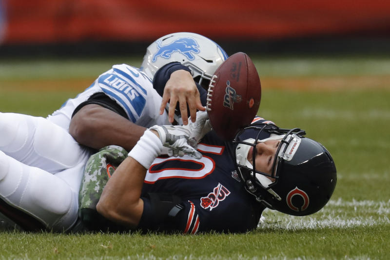 Chicago Bears quarterback Mitchell Trubisky (10) loses the ball after being hit by Detroit Lions outside linebacker Devon Kennard (42) during the first half of an NFL football game in Chicago, Sunday, Nov. 10, 2019. Chicago recovered the ball. (AP Photo/Charles Rex Arbogast)