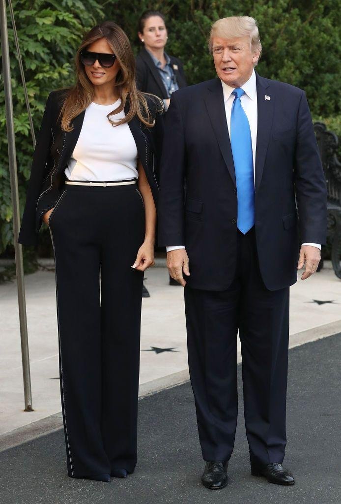 <p>The first lady wore a black suit and sunglasses before departing on Air Force 1 for a visit to France.</p>