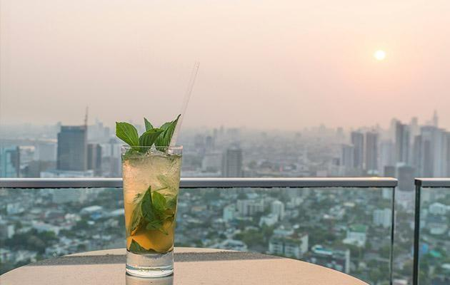 Kick back with a cocktail in hand and take in the Kuala Lumpur skyline! Photo: iStock