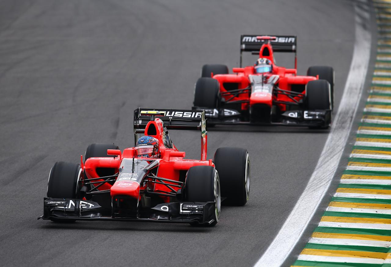 SAO PAULO, BRAZIL - NOVEMBER 24:  Charles Pic of France and Marussia drives ahead of team mate Timo Glock of Germany and Marussia during qualifying for the Brazilian Formula One Grand Prix at the Autodromo Jose Carlos Pace on November 24, 2012 in Sao Paulo, Brazil.  (Photo by Clive Mason/Getty Images)