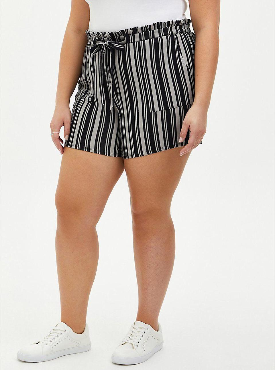 """<p>torrid.com</p><p><strong>$34.12</strong></p><p><a href=""""https://go.redirectingat.com?id=74968X1596630&url=https%3A%2F%2Fwww.torrid.com%2Fproduct%2Fmulti-stripe-ponte-paperbag-short%2F14598908.html&sref=https%3A%2F%2Fwww.thepioneerwoman.com%2Ffashion-style%2Fg37083925%2Fbest-plus-size-shorts%2F"""" rel=""""nofollow noopener"""" target=""""_blank"""" data-ylk=""""slk:Shop Now"""" class=""""link rapid-noclick-resp"""">Shop Now</a></p><p>These striped paper bag shorts are so versatile. You can easily dress them up with fun strappy heels and a cute blouse or go more casual with a tee, <a href=""""https://www.thepioneerwoman.com/fashion-style/g33214670/best-jean-jackets-for-women/"""" rel=""""nofollow noopener"""" target=""""_blank"""" data-ylk=""""slk:denim jacket"""" class=""""link rapid-noclick-resp"""">denim jacket</a>, and sneakers. </p>"""