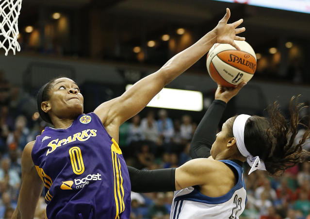 FILE - In this Aug. 12, 2014, file photo, Los Angeles Sparks guard Alana Beard (0) tries to block the shot of Minnesota Lynx forward Maya Moore (23) in the second half of a WNBA basketball game in Minneapolis. Alana Beard, a two-time Defensive Player of the Year who won a WNBA championship with the Los Angeles Sparks, is retiring after 15 years. The Sparks announced her decision on Thursday, Jan. 23, 2020. (AP Photo/Stacy Bengs, File)