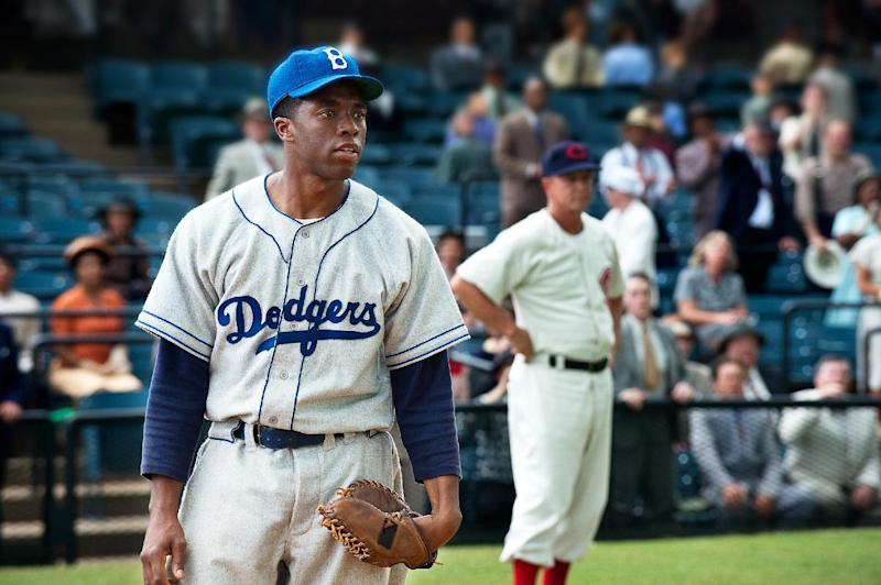 "This film image released by Warner Bros. Pictures shows Chadwick Boseman as Jackie Robinson in a scene from ""42."" Kansas City's Negro Leagues Baseball Museum is hosting an advance screening of an upcoming movie about Jackie Robinson, who broke major league baseball's color barrier. Thomas Butch of the financial firm Waddell and Reed announced Wednesday, March 20, 2013, that actors Harrison Ford and Andre Holland will be among those appearing at an April 11 screening of ""42."" The film chronicles Robinson's rise from the Negro Leagues' Kansas City Monarchs in 1945 to the Brooklyn Dodgers in 1947, when he won the inaugural Rookie of the Year award. The film opens nationwide on April 12. (AP Photo/Warner Bros. Pictures, D. Stevens)"