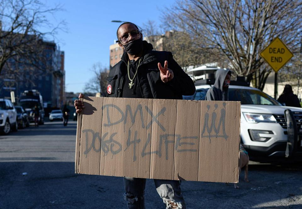 """<p>Another supporter held a sign that said, """"DMX Dogs 4 Life"""" outside of the hospital.</p>"""
