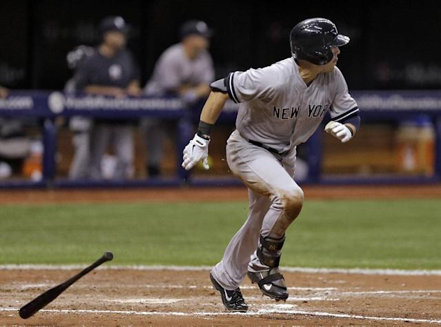 New York Yankees' Jacoby Ellsbury follows the flight of his sacrifice fly off Tampa Bay Rays relief pitcher Heath Bell that scored Yankees' Brian Roberts during sixth inning of a baseball game on Thursday, April 17, 2014, in St. Petersburg, Fla. (AP Photo/Chris O'Meara)