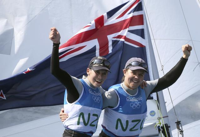 2016 Rio Olympics - Sailing - Final - Women's Two Person Dinghy - 470 - Medal Race - Marina de Gloria - Rio de Janeiro, Brazil - 18/08/2016. Jo Aleh (NZL) of New Zealand and Polly Powrie (NZL) of New Zealand celebrate silver medal. REUTERS/Benoit Tessier FOR EDITORIAL USE ONLY. NOT FOR SALE FOR MARKETING OR ADVERTISING CAMPAIGNS.