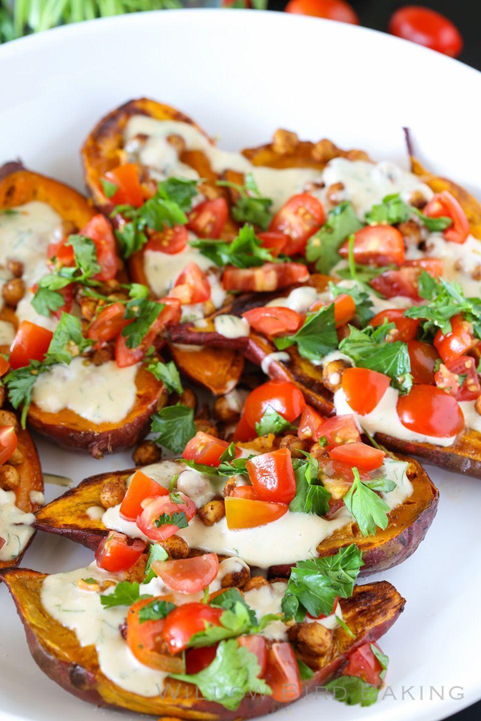 """<p>A homemade dill tahini sauce makes every bite of this dish burst with fresh flavors.</p><p><strong>Get the recipe at <a href=""""http://willowbirdbaking.com/2015/04/13/mediterranean-baked-sweet-potatoes/"""" rel=""""nofollow noopener"""" target=""""_blank"""" data-ylk=""""slk:Willow Bird Baking"""" class=""""link rapid-noclick-resp"""">Willow Bird Baking</a>.</strong></p><p><strong><strong><strong><a class=""""link rapid-noclick-resp"""" href=""""https://www.amazon.com/Nordic-Ware-Natural-Aluminum-Commercial/dp/B0049C2S32/?tag=syn-yahoo-20&ascsubtag=%5Bartid%7C10050.g.877%5Bsrc%7Cyahoo-us"""" rel=""""nofollow noopener"""" target=""""_blank"""" data-ylk=""""slk:SHOP BAKING SHEETS"""">SHOP BAKING SHEETS</a></strong></strong><br></strong></p>"""