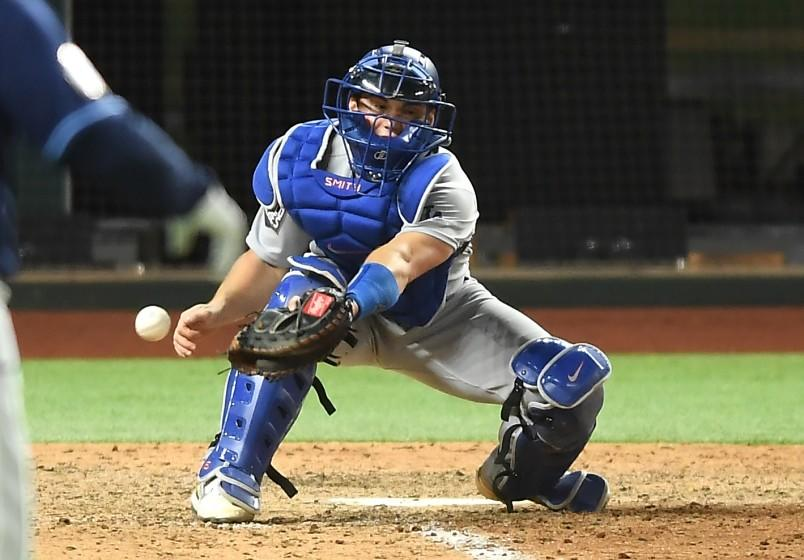 ARLINGTON, TEXAS OCTOBER 24, 2020-Dodgers catcher Will Smith drops the ball allowing the Rays.