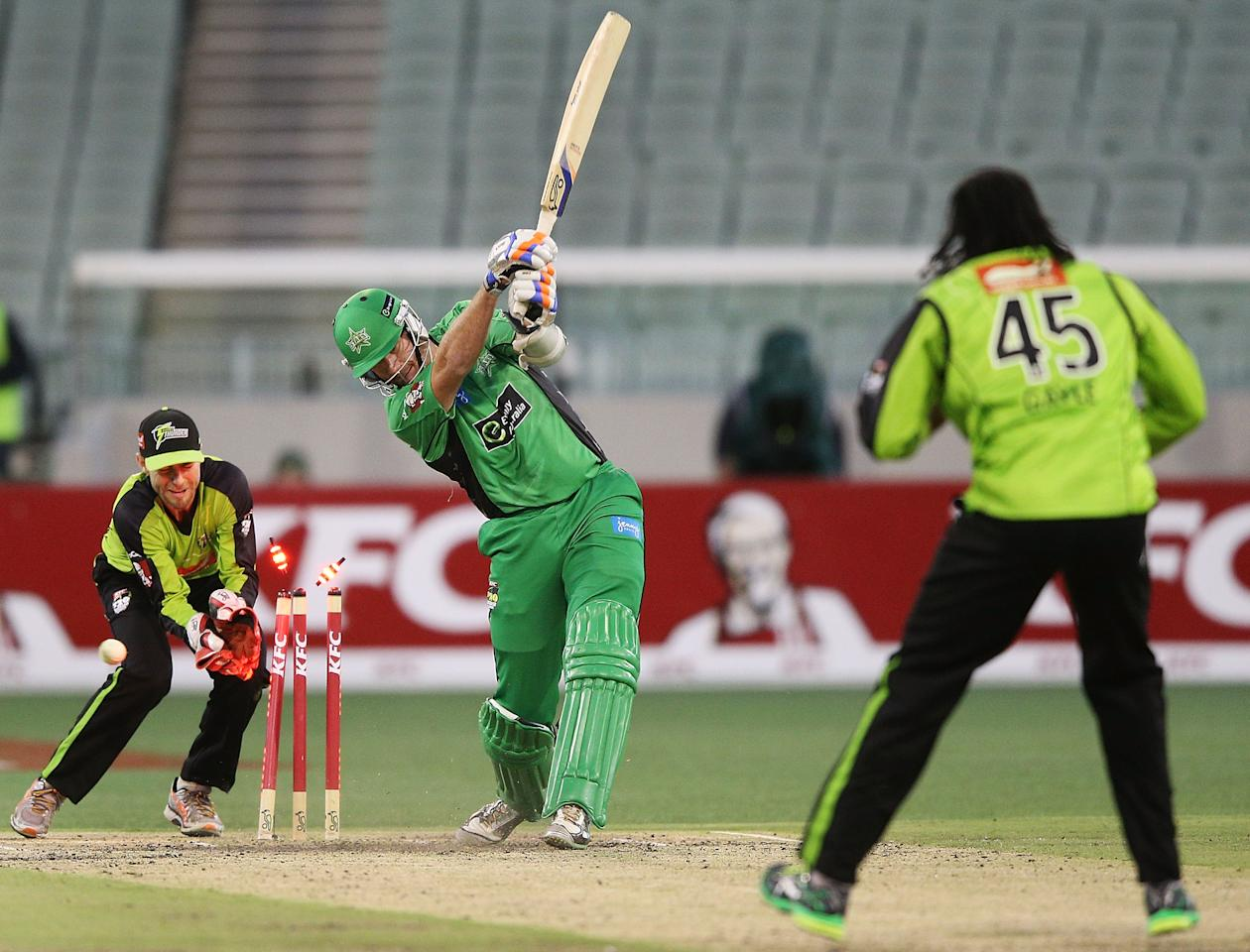 MELBOURNE, AUSTRALIA - JANUARY 08:  John Hastings of the Melbourne Stars gets bowled by Chris Gayle of the Sydney Thunder during the Big Bash League match between the Melbourne Stars and the Sydney Thunder at Melbourne Cricket Ground on January 8, 2013 in Melbourne, Australia.  (Photo by Michael Dodge/Getty Images)