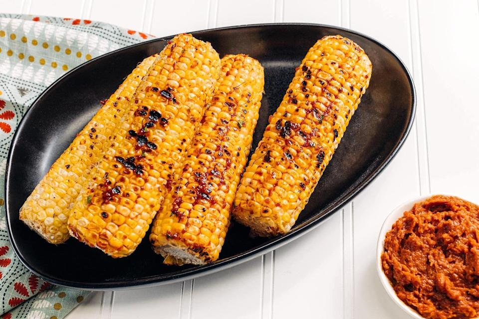"""<p>Grilling corn is one of summer's simplest and sweetest pleasures. Take that everyday charred corn to the next level by slathering it in a compound chile butter spiced with paprika, cumin and cayenne, plus a healthy dash of pomegranate molasses.</p> <p><a href=""""https://www.thedailymeal.com/recipes/grilled-corn-chile-garlic-butter?referrer=yahoo&category=beauty_food&include_utm=1&utm_medium=referral&utm_source=yahoo&utm_campaign=feed"""" rel=""""nofollow noopener"""" target=""""_blank"""" data-ylk=""""slk:For the Grilled Corn With Chile Butter recipe, click here."""" class=""""link rapid-noclick-resp"""">For the Grilled Corn With Chile Butter recipe, click here.</a></p>"""