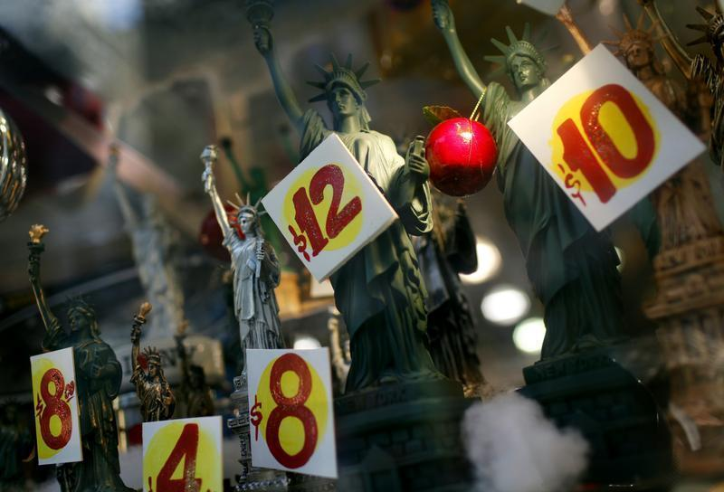 Prices are seen on replica Statues of Liberty figures in a shop window in New York City