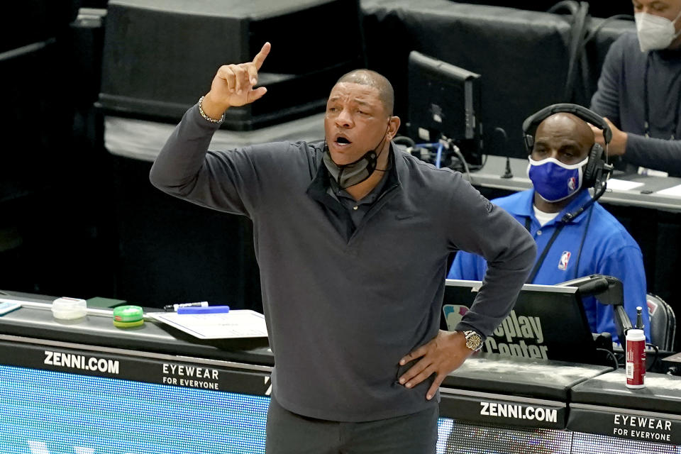 Philadelphia 76ers head coach Doc Rivers directs his team during the second half of an NBA basketball game against the Chicago Bulls Monday, May 3, 2021, in Chicago. (AP Photo/Charles Rex Arbogast)