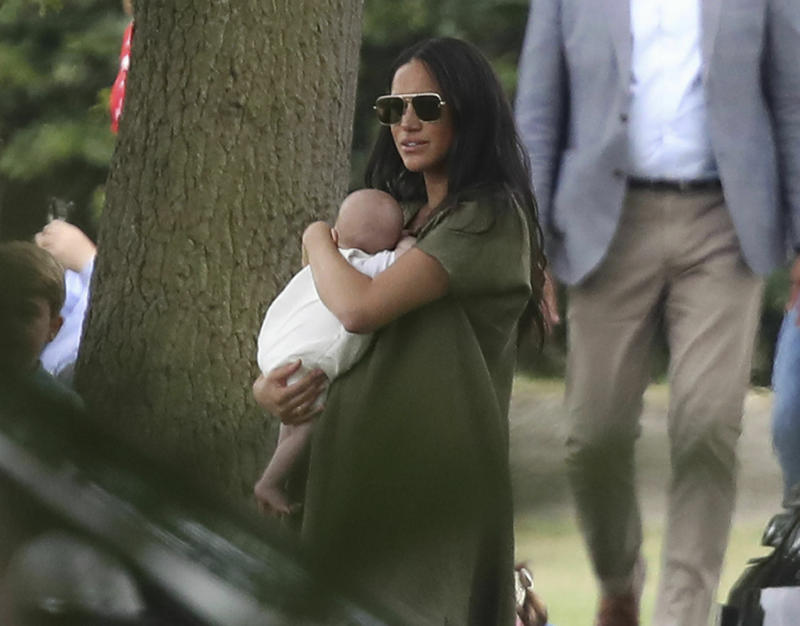 Britain's Meghan, Duchess of Sussex holding her son Archie, at the Royal Charity Polo Day at Billingbear Polo Club, Wokingham, England, Wednesday, July 10, 2019. (Andrew Matthews/PA via AP)