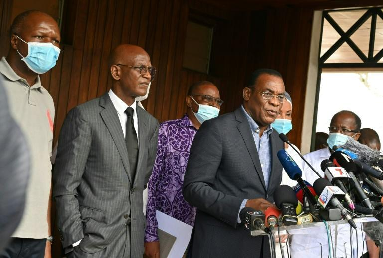 Opposition candidate Pascal Affi N'Guessan, right, announced plans for a 'transitional government' after the contested elections