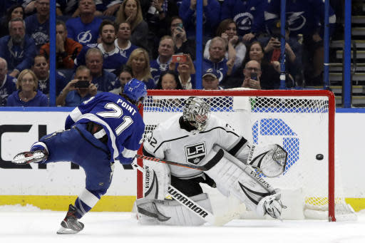 Tampa Bay Lightning center Brayden Point (21) beats Los Angeles Kings goaltender Jonathan Quick (32) during a shoot out in an NHL hockey game Tuesday, Jan. 14, 2020, in Tampa, Fla. (AP Photo/Chris O'Meara)