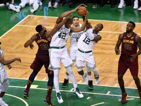 May 15, 2018; Boston, MA, USA; Boston Celtics forward Al Horford (42), forward Jayson Tatum (0), and guard Terry Rozier (12) attempt to control a rebound away from Cleveland Cavaliers center Tristan Thompson (13) during the third quarter in game two of the Eastern conference finals of the 2018 NBA Playoffs at TD Garden. Mandatory Credit: Bob DeChiara-USA TODAY Sports