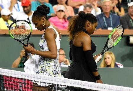 Mar 12, 2018; Indian Wells, CA, USA; Venus Williams (USA) and Serena Williams (USA) change sides during their third round match in the BNP Paribas Open at the Indian Wells Tennis Garden. Venus Williams won the match. Mandatory Credit: Jayne Kamin-Oncea-USA TODAY Sports