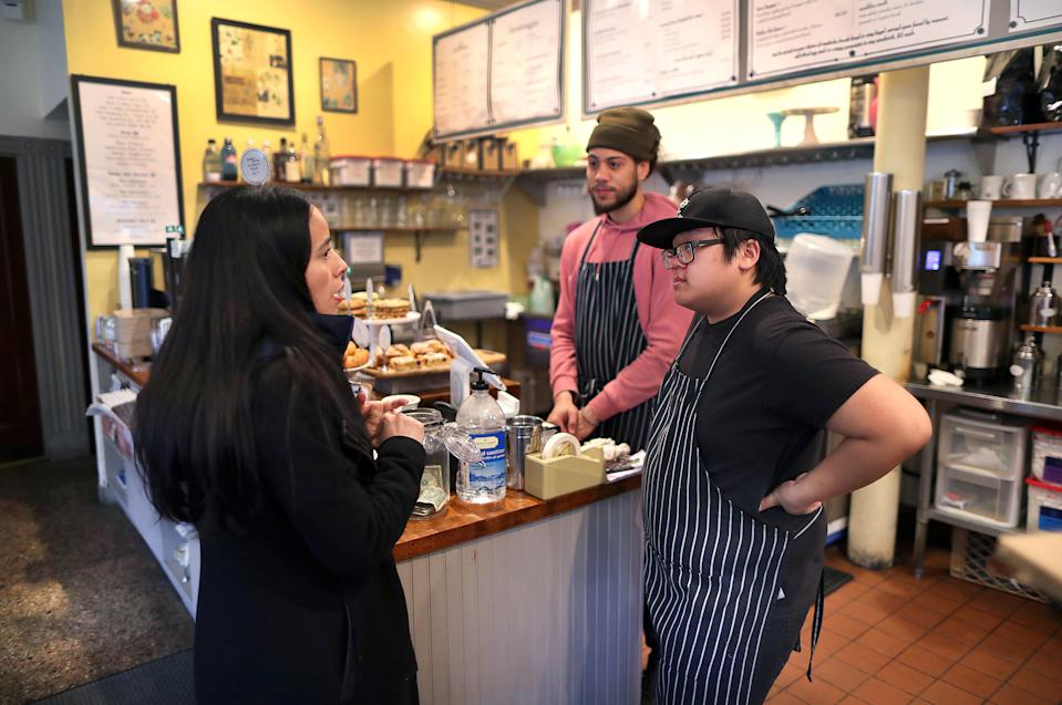 Members of Boston's Economic Development office visited businesses in Fields Corner to see what services they can provide to help them ride out the coronavirus storm on March 13, 2020 in Boston. (Photo by John Tlumacki/The Boston Globe via Getty Images)