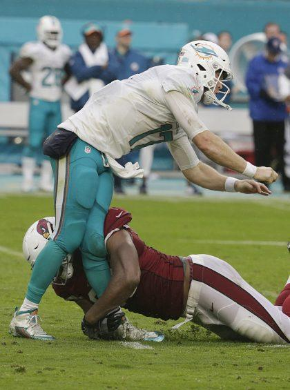 Knees don't bend like that: Calais Campbell went low on Ryan Tannehill. (AP)