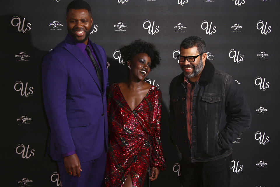Actors Winston Duke, from left, Lupita Nyong'o and director Jordan Peele pose for photographers upon arrival at the premiere of the film 'Us' in London, Thursday, March 14, 2019. (Photo by Joel C Ryan/Invision/AP)