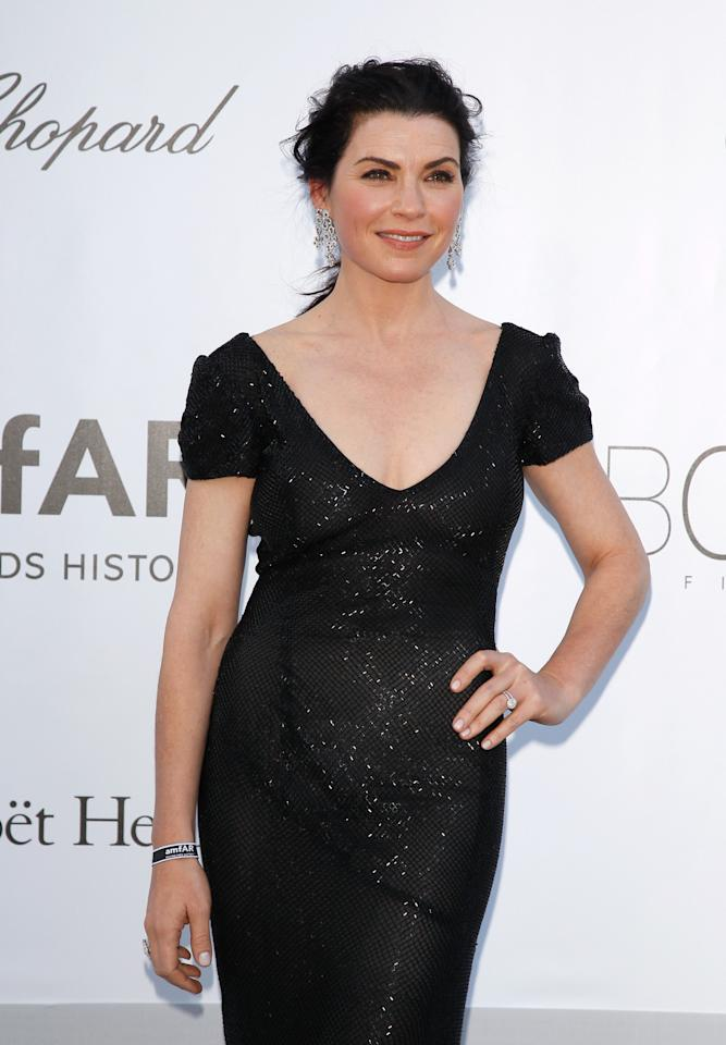 CAP D'ANTIBES, FRANCE - MAY 24:  Actress Julianna Margulies arrives at the 2012 amfAR's Cinema Against AIDS during the 65th Annual Cannes Film Festival at Hotel Du Cap on May 24, 2012 in Cap D'Antibes, France.  (Photo by Andreas Rentz/Getty Images)