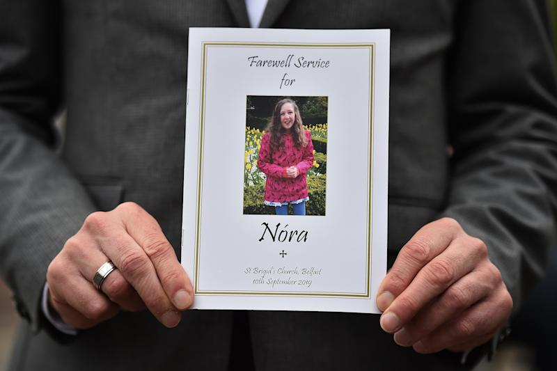 BELFAST, NORTHERN IRELAND - SEPTEMBER 10: The order of service card can be seen as the funeral of Nora Quoirin takes place at St Brigid's Church, Derryvolgie Avenue on September 10, 2019 in Belfast, Northern Ireland. The 15 year old went missing on August 3rd while on holiday with her family at the Dunsun resort in Malaysia. Her body was later discovered close to a waterfall less than two miles from the resort following a ten day search. (Photo by Charles McQuillan/Getty Images)