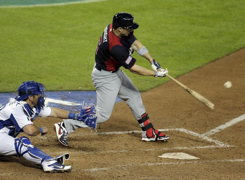 United States's David Wright hits a grand slam during the fifth inning of a World Baseball Classic game against Italy Saturday, March 9, 2013, in Phoenix. (AP Photo/Charlie Riedel)