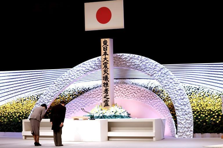 "Speaking at a ceremony in Tokyo's national theatre, Emperor Naruhito said the ""unforgettable memory of the tragedy"" persisted a decade on"