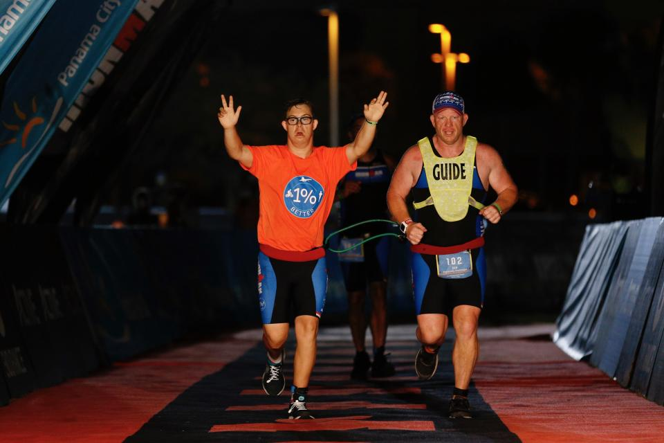 Chris Nikic crosses the ironman finish line