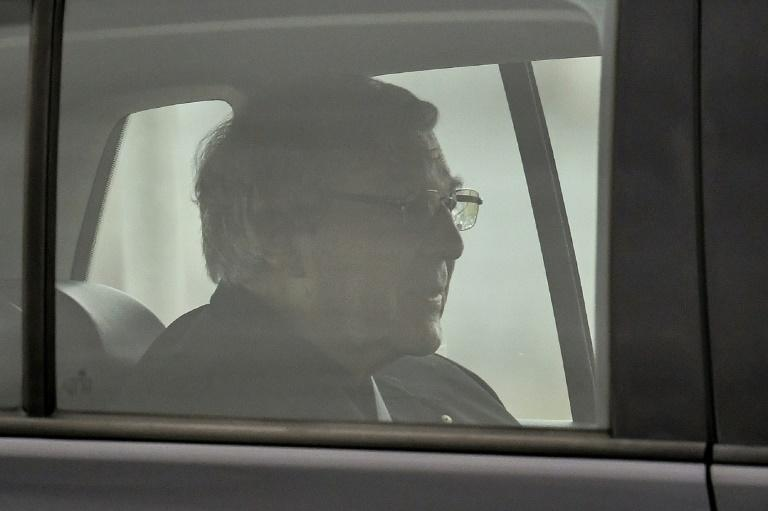 Australian Cardinal George Pell leaves a prison in Melbourne on Tuesday (AFP Photo/William WEST)
