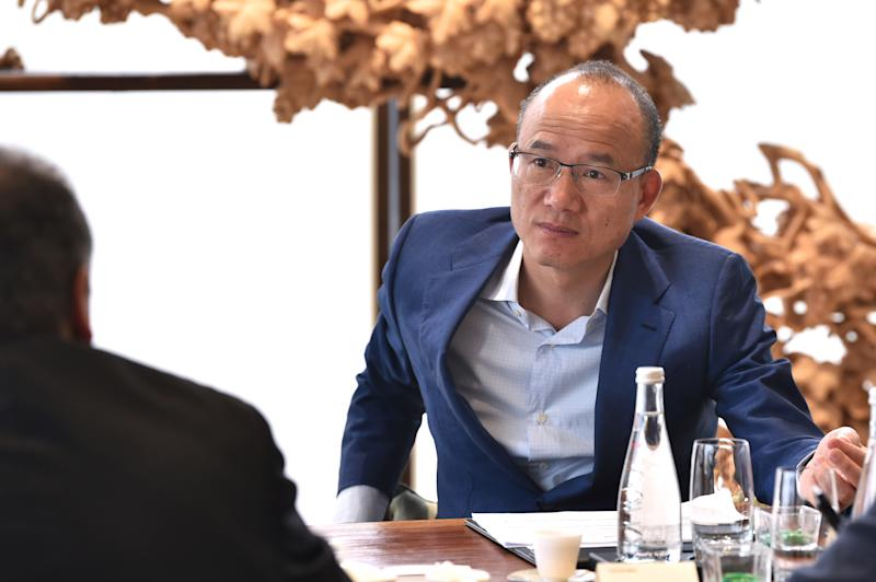 Guo Guangchang, Chairman of Fosun International speaks during an interview with media in Shanghai on May 14, 2019. (Photo by Hector RETAMAL / AFP) (Photo credit should read HECTOR RETAMAL/AFP via Getty Images)