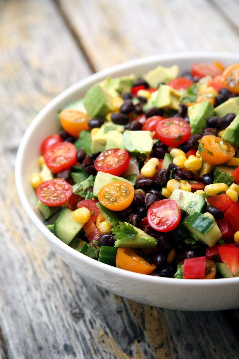 """<p>Crafted with simple ingredients, this quick, refreshing, hydrating salad combines the flavors of black beans, cucumbers, tomatoes, lime juice, and cilantro. We don't blame you if you want to eat this salad every single day - it's that good.</p> <p><strong>Get the recipe:</strong> <a href=""""https://www.popsugar.com/fitness/Cucumber-Black-Bean-Corn-Tomato-Avocado-Salad-37842951"""" class=""""link rapid-noclick-resp"""" rel=""""nofollow noopener"""" target=""""_blank"""" data-ylk=""""slk:cucumber, black bean, corn, tomato, and avocado salad"""">cucumber, black bean, corn, tomato, and avocado salad</a></p>"""