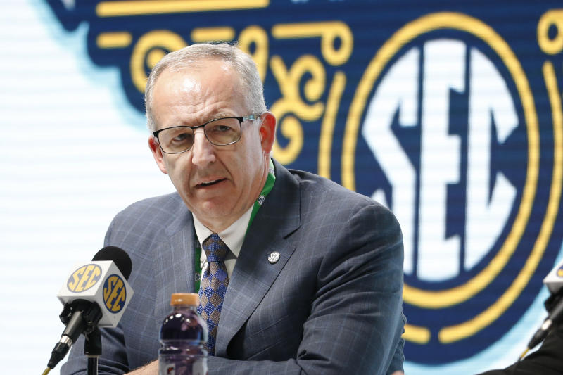 FILE - In this March 11, 2020, file photo, Southeastern Conference Commissioner Greg Sankey speaks in Nashville, Tenn. Southeastern Conference schools will be able to bring football and basketball players back to campus for voluntary activities starting June 8 at the discretion of each university. The SEC's announcement Friday, May 22, 2020, is the latest sign of encouragement that a college football season in at least some form can go on this fall.(AP Photo/Mark Humphrey, File)