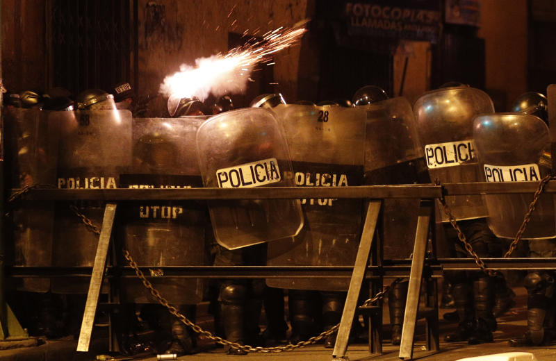 "Police fire tear gas at demonstrators during a protest against the reelection of President Evo Morales, in La Paz, Bolivia, Thursday, Nov. 7, 2019. The United Nations on Thursday urged Bolivia's government and opposition to restore ""dialogue and peace"" after a third person was killed in street clashes that erupted after a disputed presidential election on Oct. 20. (AP Photo/Juan Karita)"
