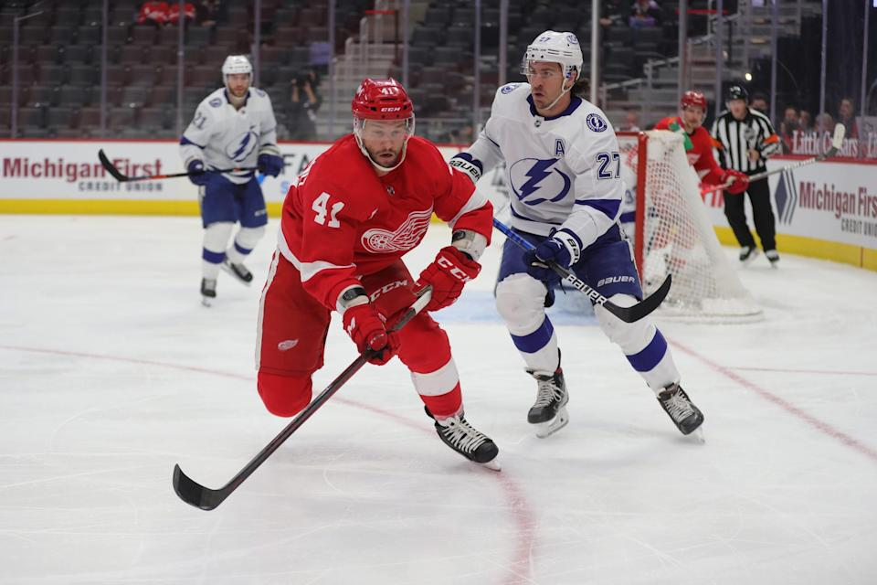 Red Wings center Luke Glendening goes after the puck against Lightning defenseman Ryan McDonagh during the first period on Sunday, May 2, 2021, at Little Caesars Arena.