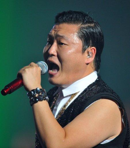 """South Korean singer Park Jae-sang, also known as Psy, performs during his concert at Seoul on October 2, 2012. The 34-year-old singer shot to international fame when his """"Gangnam Style"""" video went viral shortly after being posted on YouTube in mid-July"""
