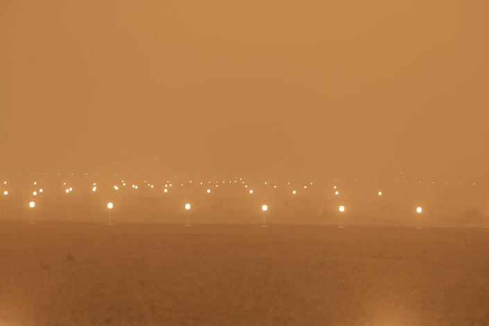 A view of the runway during a sandstorm blown over from North Africa known as