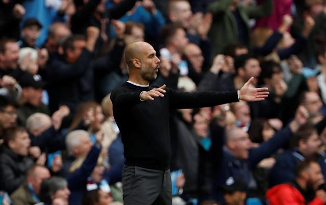 """Soccer Football - Premier League - Manchester City v Swansea City - Etihad Stadium, Manchester, Britain - April 22, 2018 Manchester City manager Pep Guardiola celebrates their third goal scored by Kevin De Bruyne Action Images via Reuters/Lee Smith EDITORIAL USE ONLY. No use with unauthorized audio, video, data, fixture lists, club/league logos or """"live"""" services. Online in-match use limited to 75 images, no video emulation. No use in betting, games or single club/league/player publications. Please contact your account representative for further details."""