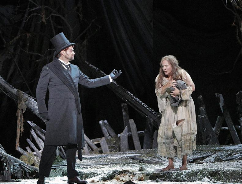 """This undated publicity photo provided by the San Francisco Opera shows Ildar Abdrazakov as Mefistofele and Patricia Racette as Margherita in Act III during the dress rehearsal of """"Mefistofele,"""" in San Francisco. (AP Photo/Copyright San Francisco Opera, Cory Weaver)"""