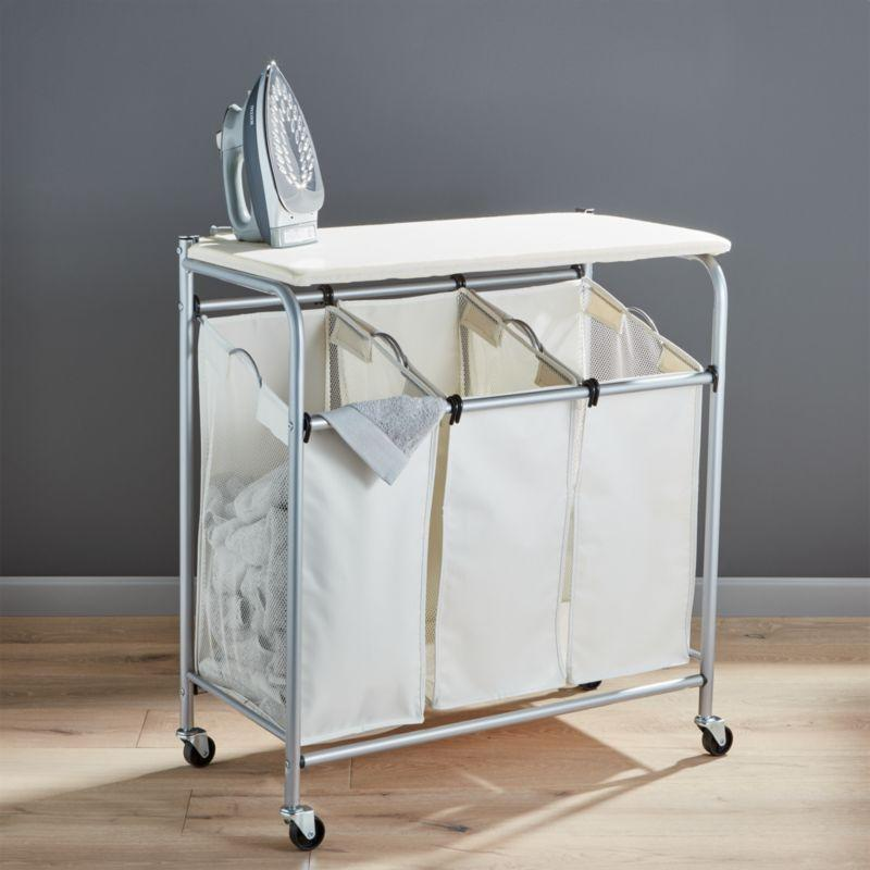 """<p><strong>Crate and Barrel </strong></p><p>crateandbarrel.com</p><p><strong>$59.95</strong></p><p><a href=""""https://go.redirectingat.com?id=74968X1596630&url=https%3A%2F%2Fwww.crateandbarrel.com%2Ftriple-laundry-sorter-with-ironing-board%2Fs243394&sref=https%3A%2F%2Fwww.goodhousekeeping.com%2Fhome%2Fcleaning%2Fg35217293%2Fbest-laundry-hamper-baskets%2F"""" rel=""""nofollow noopener"""" target=""""_blank"""" data-ylk=""""slk:Shop Now"""" class=""""link rapid-noclick-resp"""">Shop Now</a></p><p>It's more than just a laundry hamper: This three-part sorter also provides a convenient spot to sort, fold, and iron clean clothes and linens. You can even roll it to and from your laundry room (and back again) because it has wheels. </p>"""