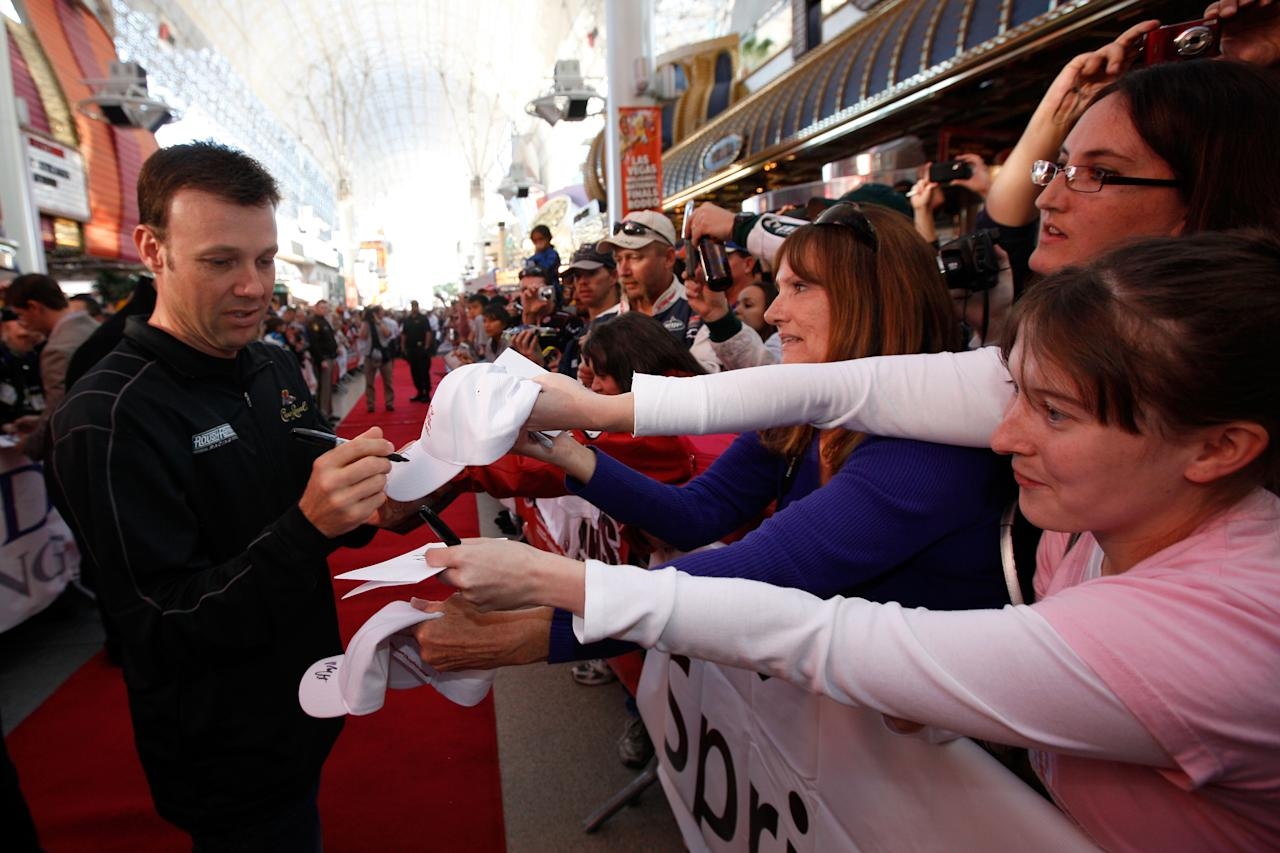 LAS VEGAS, NV - NOVEMBER 30:  Driver Matt Kenseth signs his autograph at the Fan Fesitval presented by Las Vegas Motor Speedway during the NASCAR Sprint Cup Series Champion's Week at the Fremont Street Experience on November 30, 2011 in Las Vegas, Nevada.  (Photo by Chris Graythen/Getty Images for NASCAR)