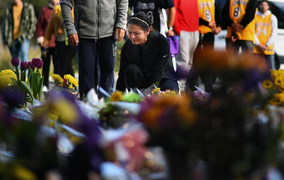Sophy Peniche of Camarillo pays her respects at a makeshift memorial outside of Kobe Bryant's Mamba Sports Academy.