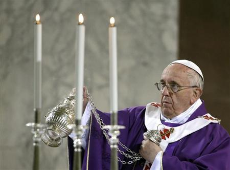 Pope Francis blesses the altar during Ash Wednesday at Santa Sabina Basilica in Rome