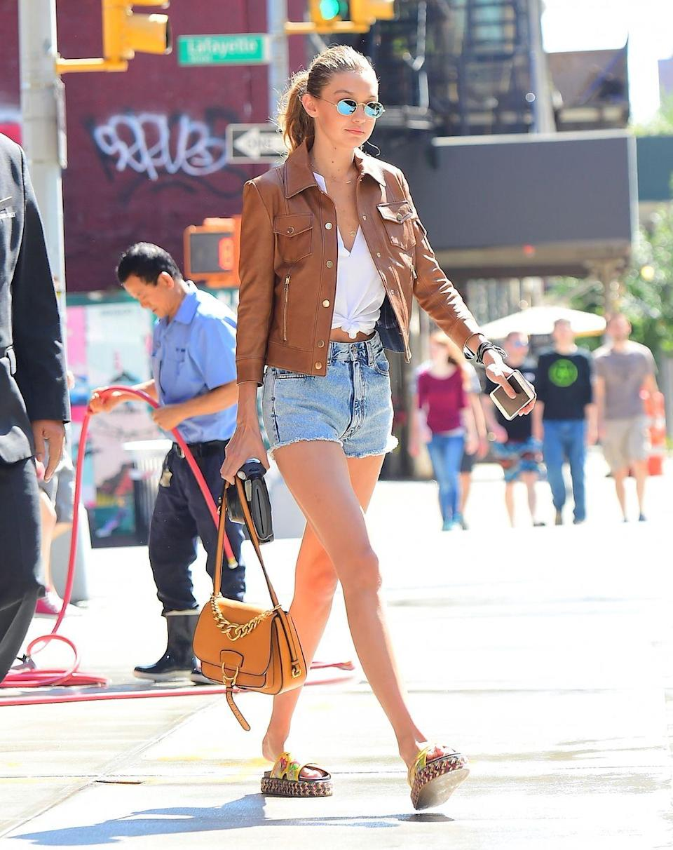 <p>Hadid wears denim shorts and a tan leather jacket on her way to a fitting for Kanye West's Yeezy Season 4 Fashion Show in NYC. </p>